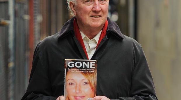 Peter Lawrence with a copy of 'Gone: The Disappearance of Claudia Lawrence and Her Father's Desperate Search for the Truth' by Neil Root.