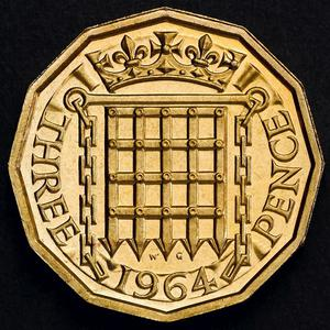 Photo issued by HM Treasury showing the reverse or details side of a 12-sided three pence piece or Threepenny bit which was in circulation from 1937 until decimalisation in 1971, as a new one pound coin announced by the Government today, which will be the most secure coin in circulation in the world, will have the same shape as the pre-decimal coin.