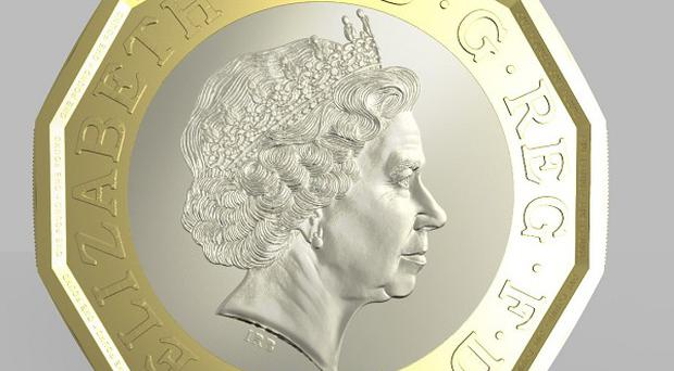 Photo issued by HM Treasury of the side of a new one pound coin announced by the Government, which will be the most secure coin in circulation in the world, the new coin will have the same shape as the 12-sided pre-decimal three pence piece or 'Threepenny bit'.