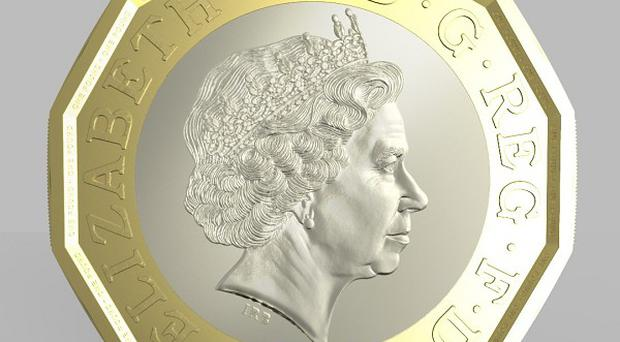 Undated handout photo issued by HM Treasury of the side of a new one pound coin announced by the Government, which will be the most secure coin in circulation in the world, the new coin will have the same shape as the 12-sided pre-decimal three pence piece or âThreepenny bitâ.