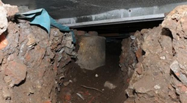 A 50ft tunnel that was dug by thieves from nearby wasteland into the Tesco on Liverpool Road, Eccles.