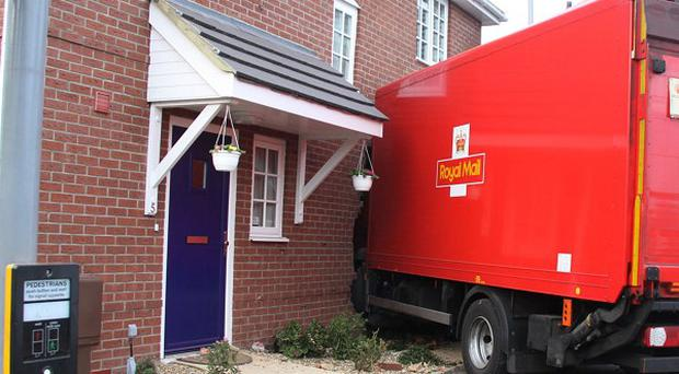 A Royal Mail lorry crashed into the side of a house in Gosport