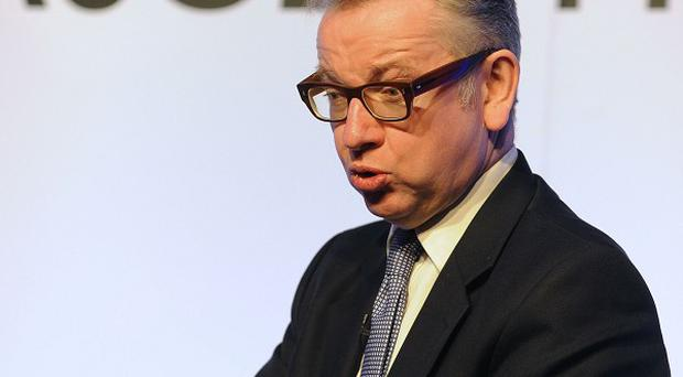 Education Secretary Michael Gove answers questions during the ASCL Annual Conference