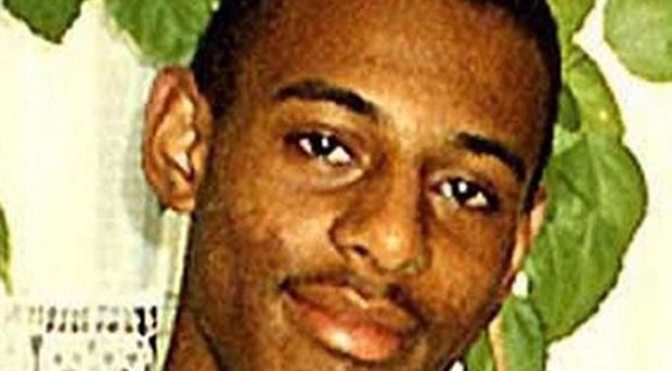 Police arrested two teenagers after an incident at the Stephen Lawrence memorial plaque in London