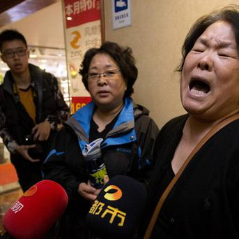 Relatives of passengers have faced an agonising wait for news (AP)