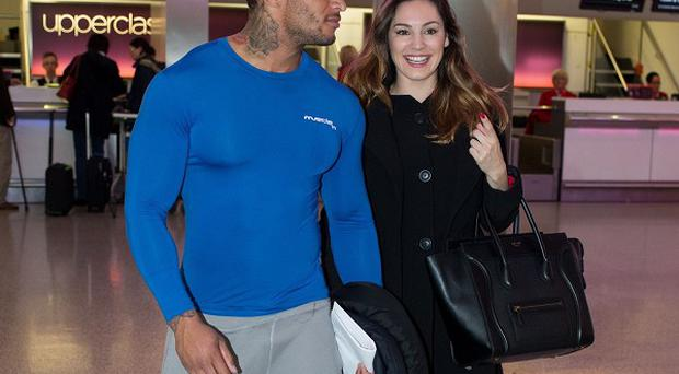 Kelly Brook with her reported fiance David McIntosh at Heathrow Airport