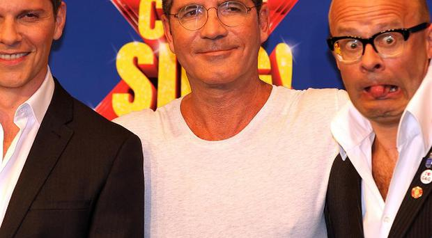 Nigel Harman (left) will play Simon Cowell (centre) in the musical penned by Harry Hill (right).