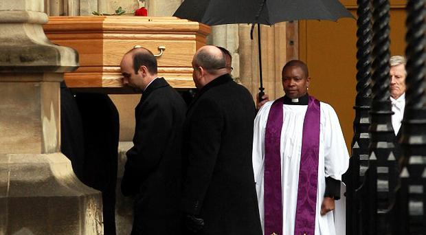 Tony Benn's coffin arrives at the Palace of Westminster to be placed in the Chapel of St Mary Undercroft.