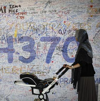 A message board for passengers aboard the missing Malaysia Airlines plane at Kuala Lumpur International Airport (AP)