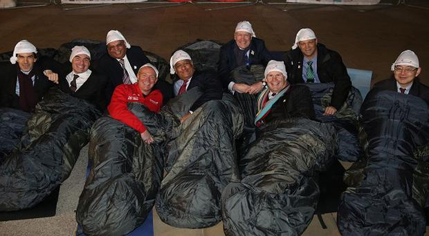 Left to right Manny Pinon - Ampito Group, Joel Cohen - Luminaire Films, John Athwal - Premier Decorations, Mike Tobin OBE - TelecityGroup, Sheetal Kapoor - The Edinburgh Collection, Sir Tony Ainsworth - Action for Children, Tim Griffith - Dell, Edi Hienrich - Herbalife and Dave Chan - Barclaycard, during the CEO Sleepout with Action for Children, in London's Paternoster Square.