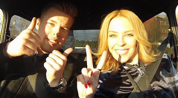 The Voice UK coach Kylie Minogue with her contestant Jamie Johnson in his mini ahead of this weekend's semi-final programme in the BBC talent show.