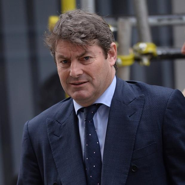 Charlie Brooks , the husband of former News International chief executive Rebekah Brooks, arrivies at the Old Bailey as the phone-hacking trial continues