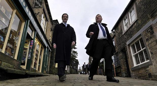 Housing minister Kris Hopkins, right, pictured with Chancellor George Osborne, denied the Government was fuelling property price rises