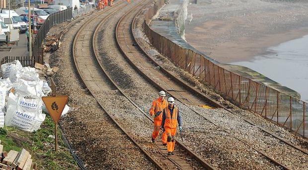 Network Rail engineers carry out repair work to the storm-wrecked Great Western Main Line in Dawlish, Devon