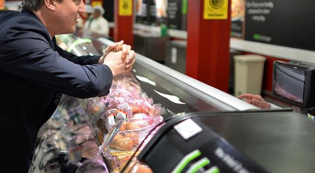 Prime Minister David Cameron meets staff and shoppers at Asda in Clapham, south London