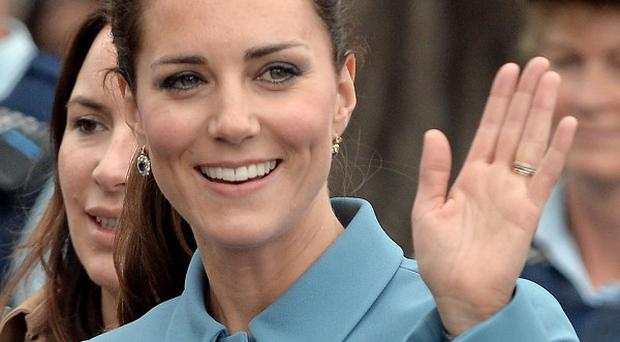 The Duchess of Cambridge waves during a wreath-laying and commemoration ceremony at the War Memorial in Seymour Square, Blenheim