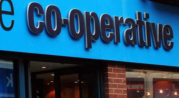 The Co-op's banking arm has reported a £1.3 billion loss.