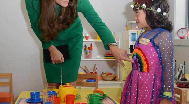 The Duchess of Cambridge meets Bailey Taylor, six, during her visit to the Rainbow Place Children's Hospice in Hamilton, New Zealand