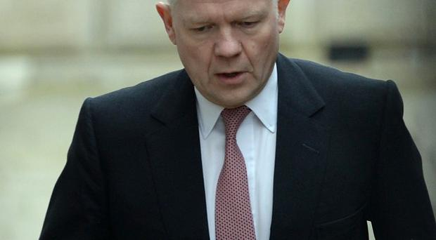 Foreign Secretary William Hague is attending crisis talks on Ukraine