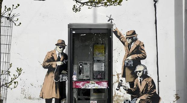 A new graffiti street art piece, suspected of being by Banksy, which appeared on the side of a house on Fairview Road in Cheltenham
