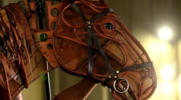 Musicians in the West End production of War Horse want an order saying they cannot be replaced with a soundtrack
