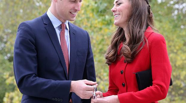 The Duke and Duchess of Cambridge prepare to cut the 'flower ribbon' when they officially open the Visitor's Centre at the Botanical Gardens in Christchurch, New Zealand, during their three-week tour of Australia and New Zealand.