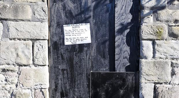 A notice sits where the latest officially confirmed Banksy artwork Mobile Lovers was