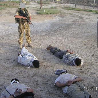 This image of detained Iraqis being guarded by a British soldier was shown at the the Al-Sweady Inquiry