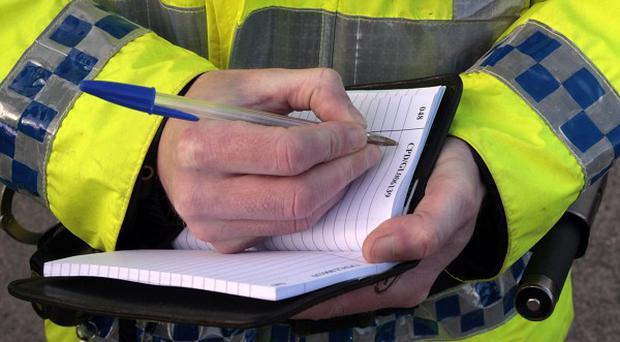 Police are investigating the death of a woman at a flat in East Ayrshire
