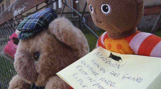 Tributes outside the home in Kelty, Fife, following the 'suspicious' death of a two-year-old girl