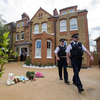 Police at a house in New Malden, south London, after a woman was arrested following the discovery of three dead children