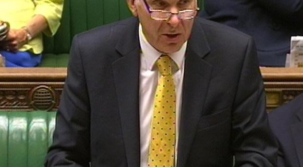 Business Secretary Vince Cable: Grilled over the sell-off of Royal Mail