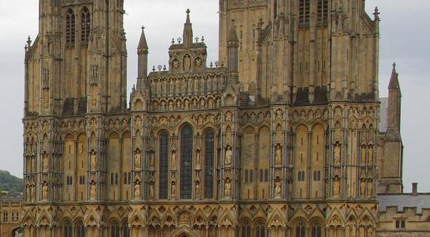 A woman has become trapped after a fall at Wells Cathedral