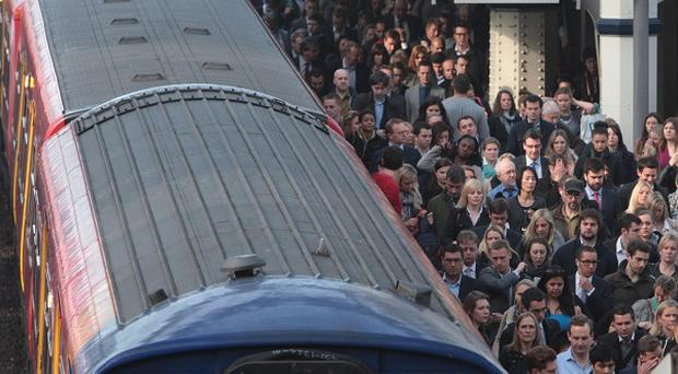Commuters at Waterloo station on the second day of a 48 hour strike by tube workers