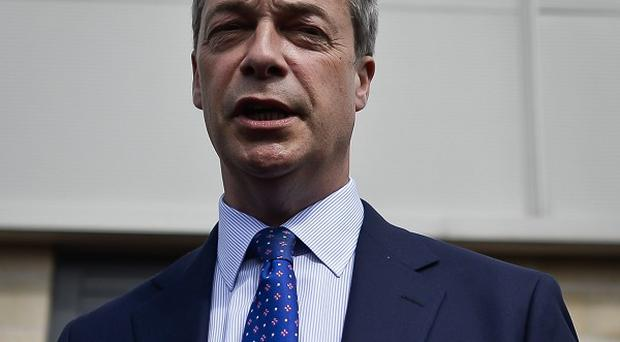 Nigel Farage was hit by an egg on a campaign visit to Nottingham