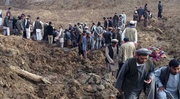 British charities are mobilising to help with the rescue effort after a landslide is feared to have buried 2,700 people in a village in Afghanistan (AP)