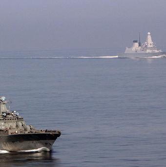 Royal Navy destroyer HMS Dragon, right, tracks Russian ship Vice Admiral Kulakov (left)