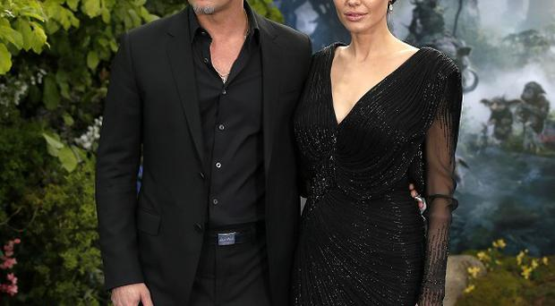 Brad Pitt and Angelina Jolie attending the premiere of Maleficent at Kensington Palace