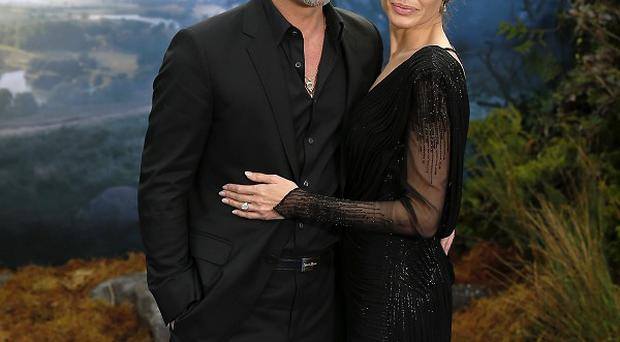 Brad Pitt and Angelina Jolie attending the premiere of Maleficent at Kensington Palace, London.