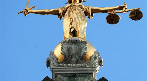 A woman was beaten up by her violent partner who put her fingers between a pair of scissors, a court has been told