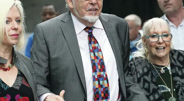 Rolf Harris arrives at Southwark Crown Court supported by family members