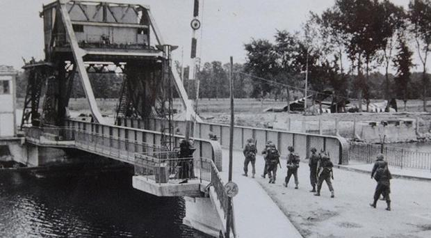 Troops crossing Pegasus Bridge, site of one of the most famous assaults on D-Day