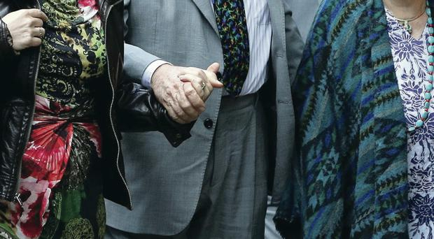 Rolf Harris arrives at court yesterday with his daughter Bindi (left) and wife Alwen Hughes