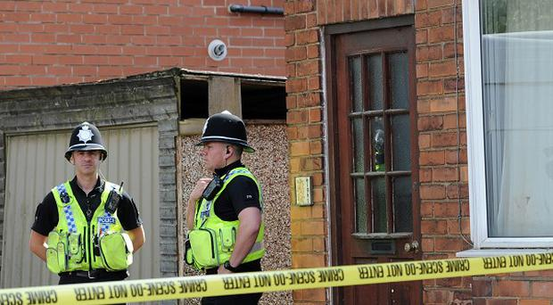 Police officers at a house in Burnholme Grove, York which is being searched after a man was arrested in connection with the disappearance of Claudia Lawrence