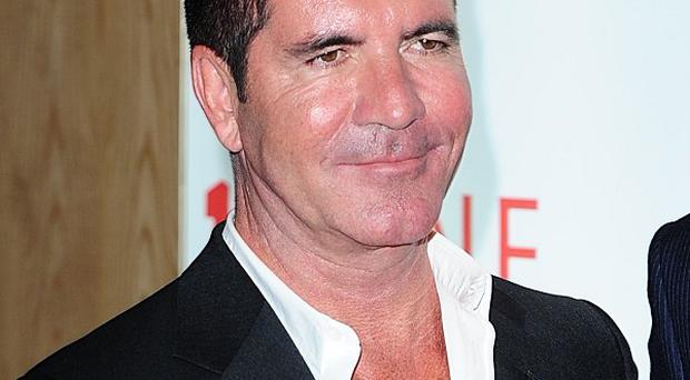 X Factor boss Simon Cowell has seen his worth swell to £300 million