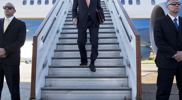 US Secretary of State John Kerry arrives at Stansted Airport ahead of a meeting on the crisis in Syria (AP)