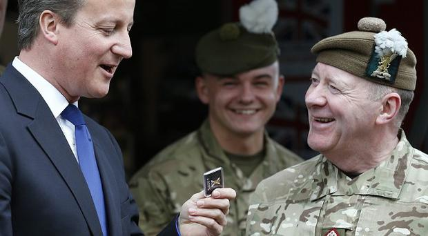 Prime Minister David Cameron meets members of the armed forces in Glasgow