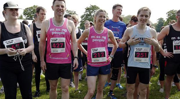 Kate, right, and Gerry, left, McCann take part in the Missing People Charity Run on Clapham Common in London