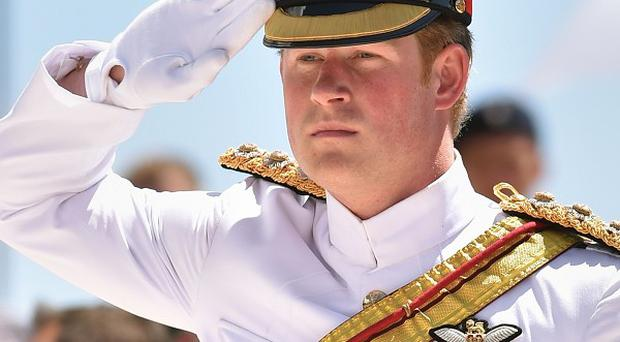 Prince Harry salutes after laying a wreath on behalf of The Queen during a commemoration service at Monte Cassino cemetery