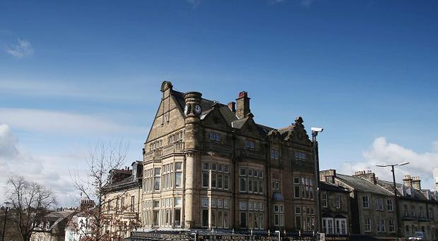 Harrogate has topped a poll of happiest places to live in the UK